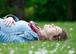 girl_lying_grass_pregnancy_stomach_smiling_happiness_55127_3840x2400